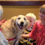 The kids enjoy a visit from therapy dogs.