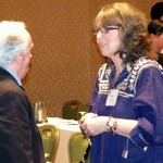 Connections keynote speaker, David Roche, chats with Peggy O'Grady, a social worker at the UCSF Center for Craniofacial Anomalies.